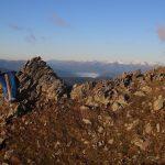 Ráno suším spacák a obdivuju výhledy na Vysoké Taury.